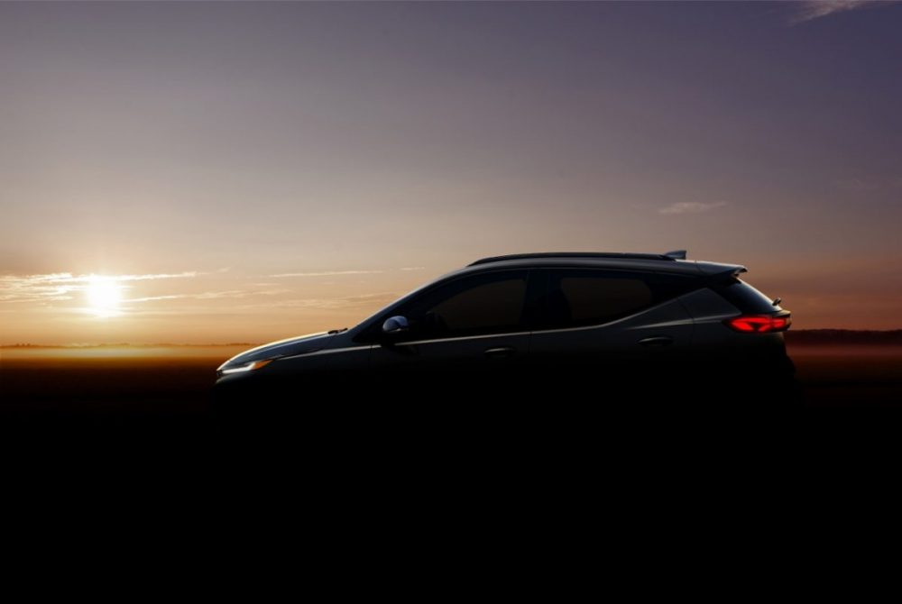 A teaser of the 2022 Chevrolet Bolt EUV in front of a sunset