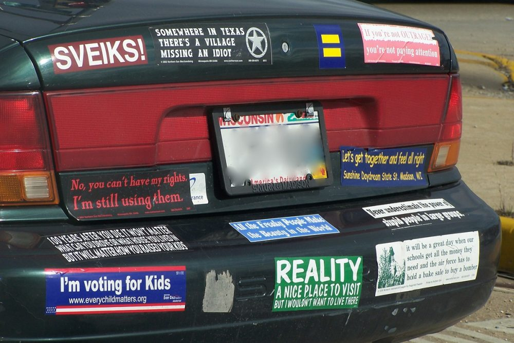 black car with bumper stickers