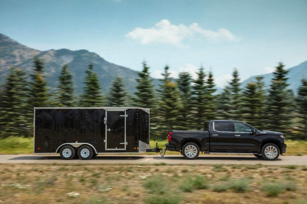 Side view of 2021 Chevrolet Silverado 1500 towing a trailer