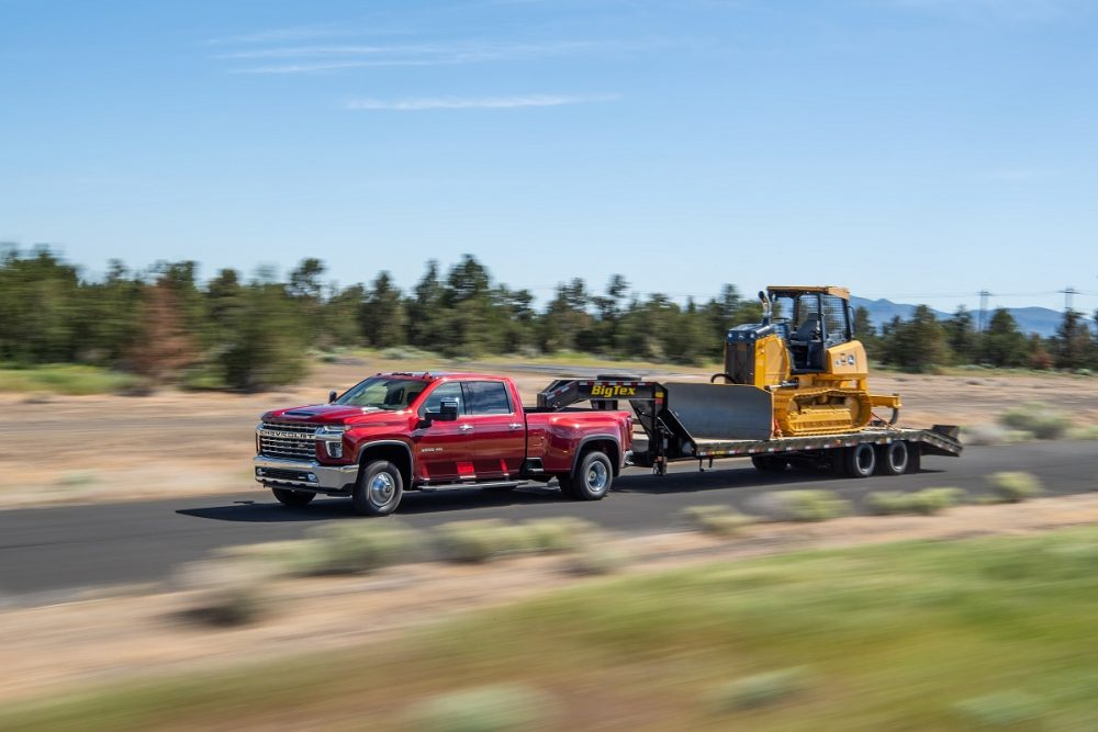 The 2021 Silverado 3500 HD towing equipment on the street