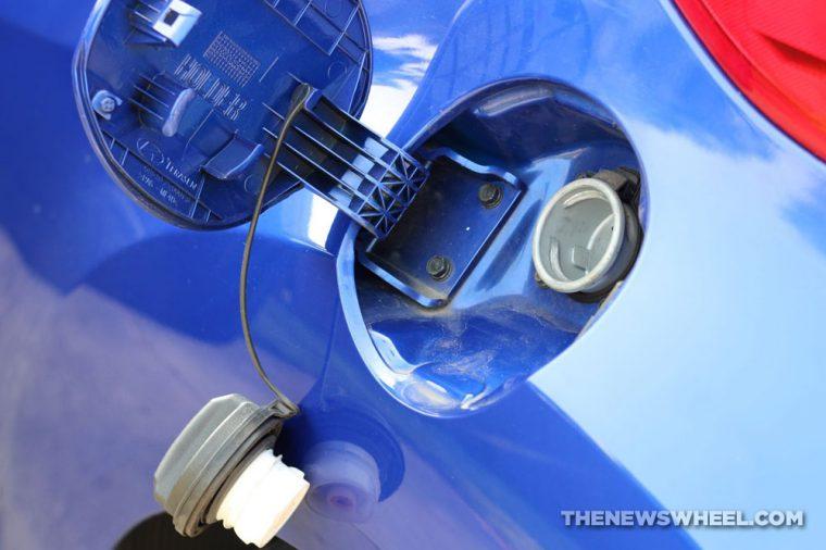 Gas cap fuel tank refill pump open
