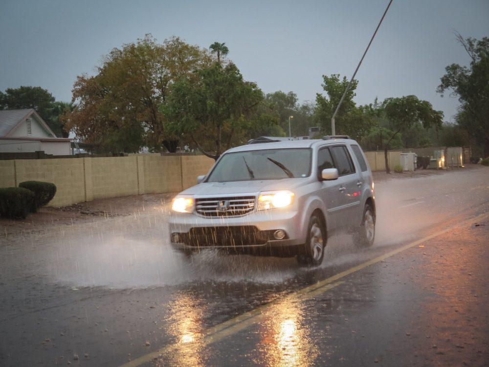 flooding rain tropical storm monsoon car vehicle