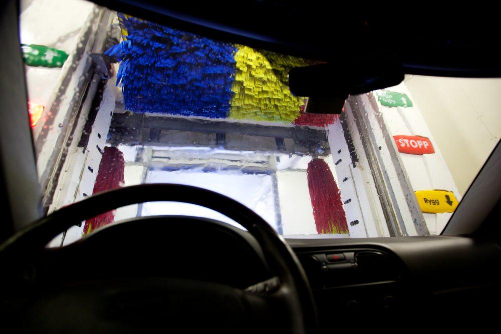 A car going through an automated car wash