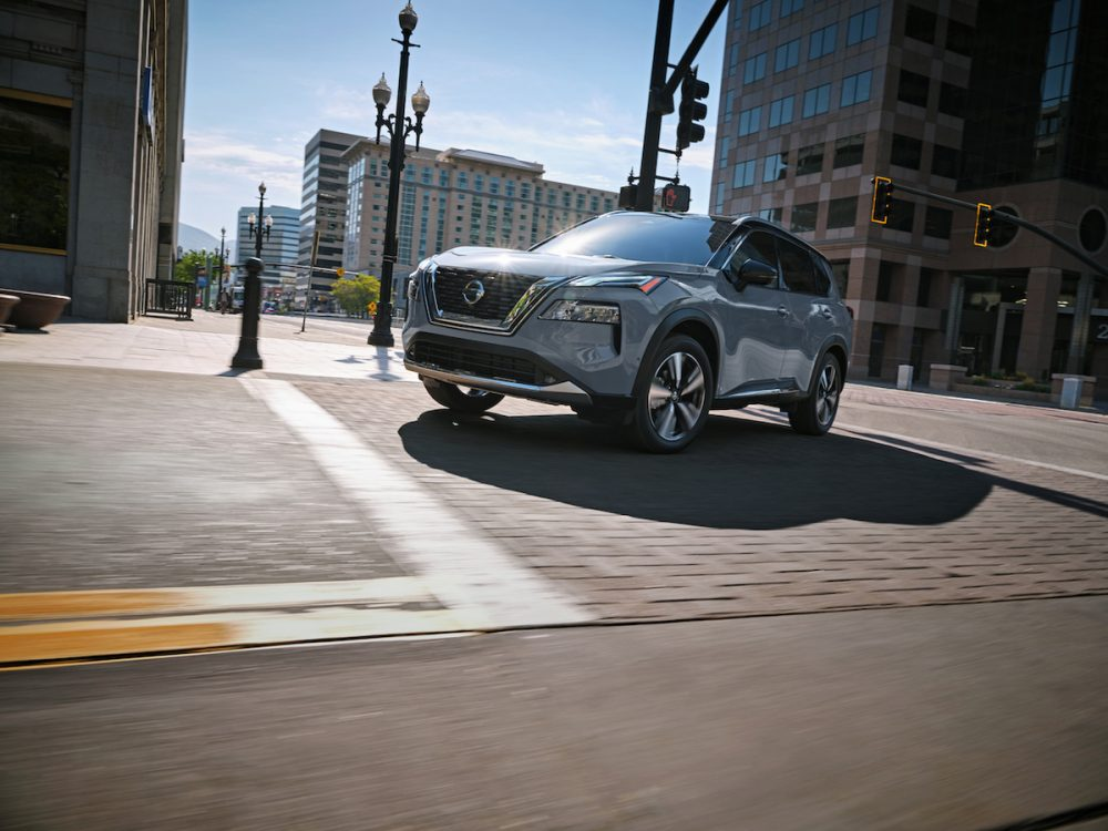 2021 Nissan Rogue driving on city streets