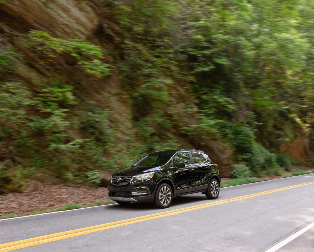 2021 Buick Encore driving down a country road