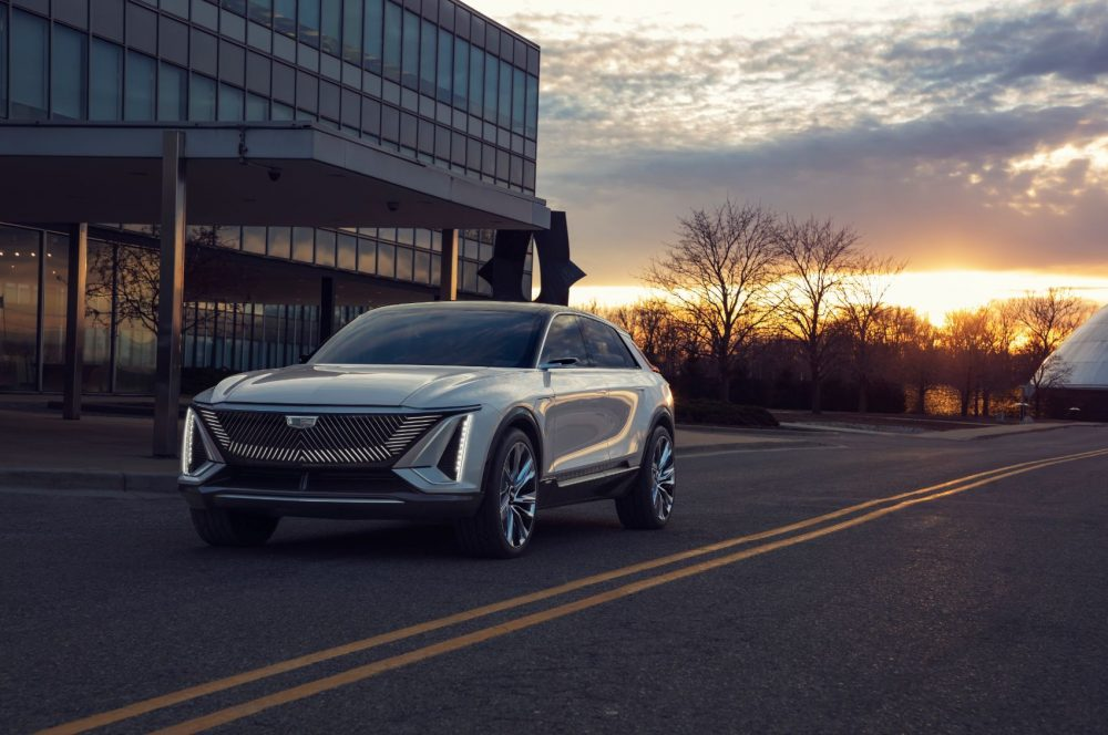 Cadillac Lyriq EV crossover driving at sunset