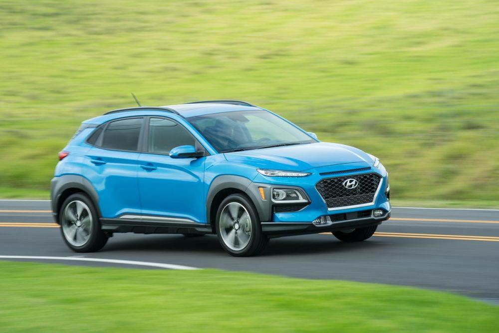 2021 Hyundai Kona in blue driving on a road