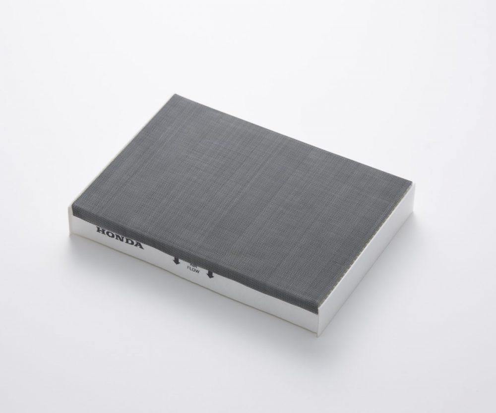 grey Honda Kurumask mask filter over a standard white cabin filter
