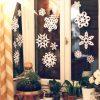 Nissan paper snowflakes on a dark window