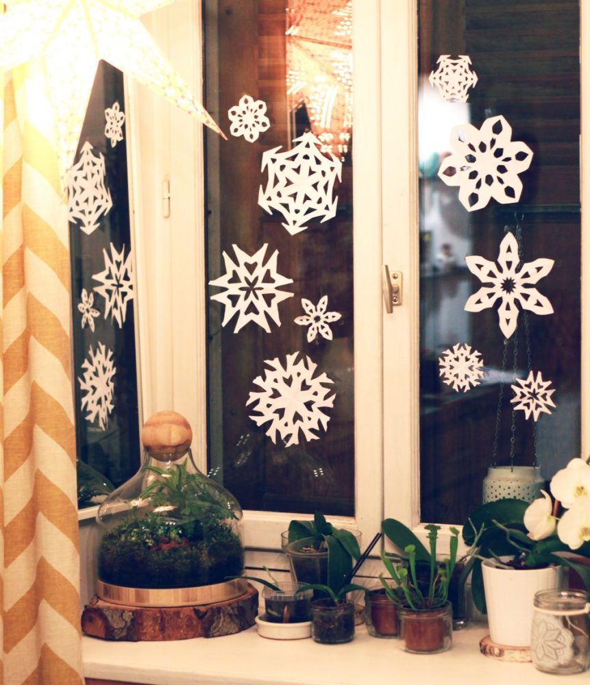 Nissan paper snowflakes on a dark window