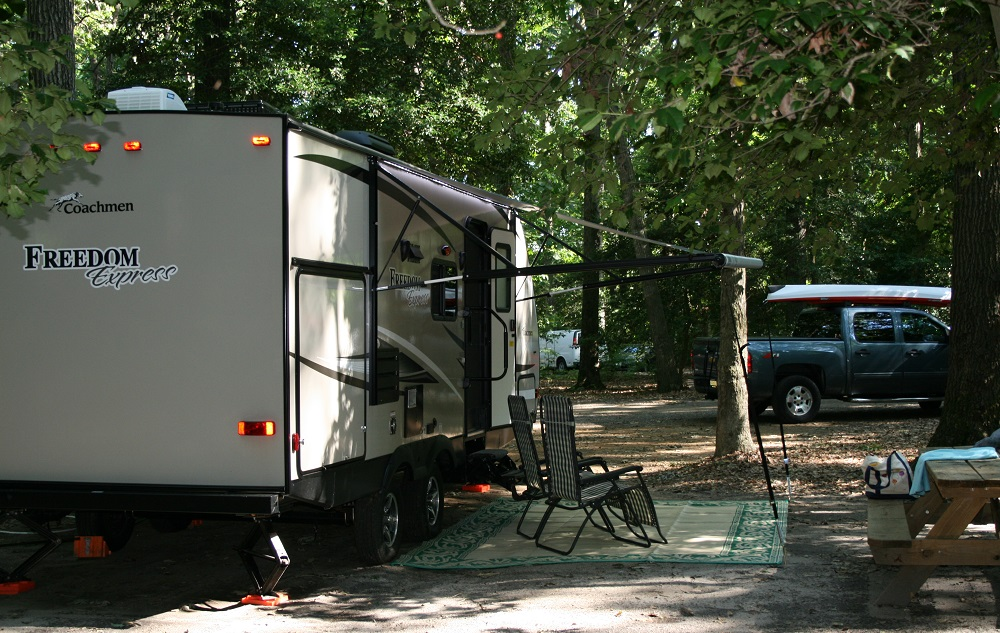 RV popularity is booming - Travel Trailer in a woody campground
