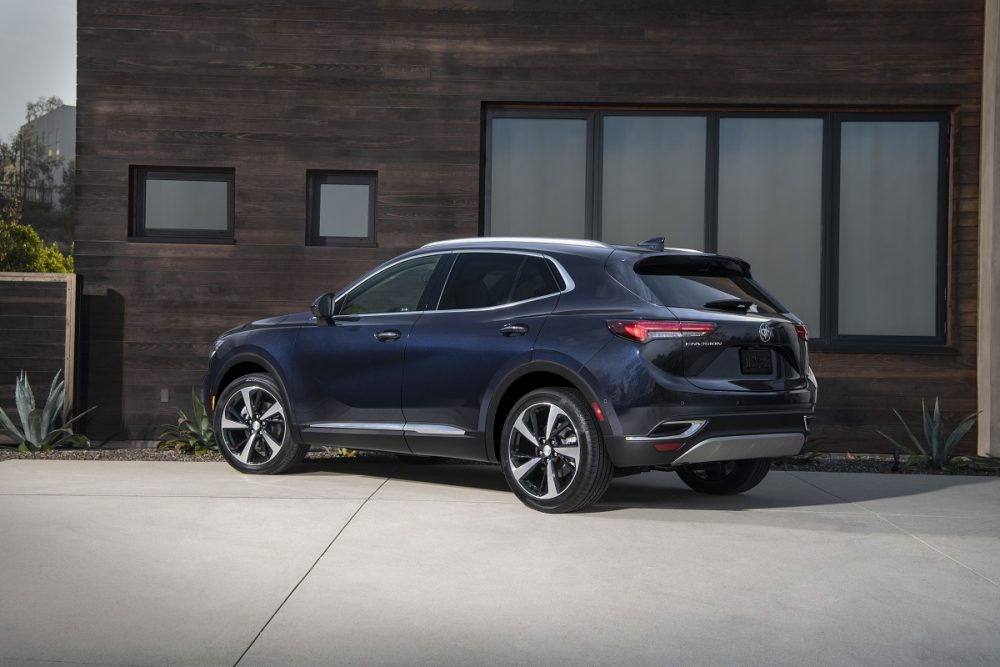 A side view of the 2021 Buick Envision parked in front of a house