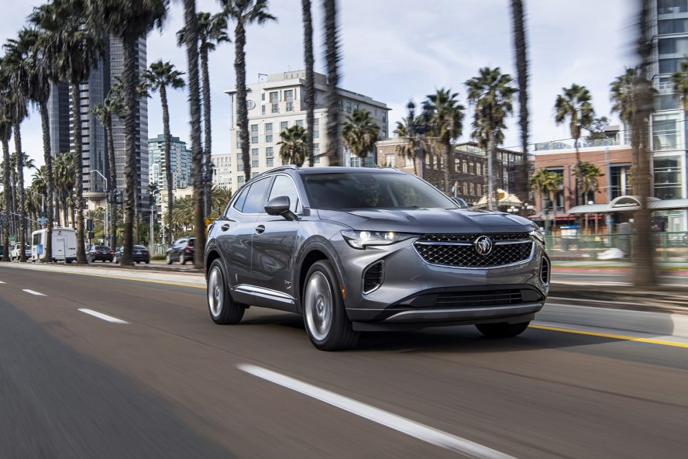 Front side view of 2021 Buick Envision driving down city street