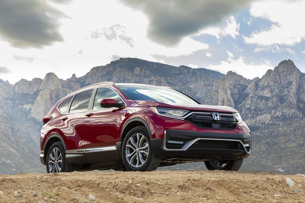 2021 Honda CR-V Hybrid posing dramatically in front of rocky mountains