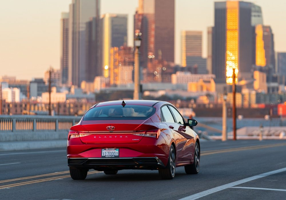 Rear view of 2021 Hyundai Elantra driving in city