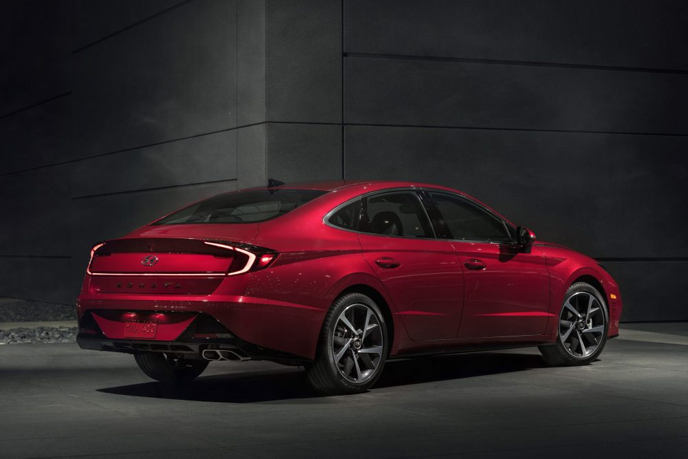 Rear side view of parked red Hyundai Sonata