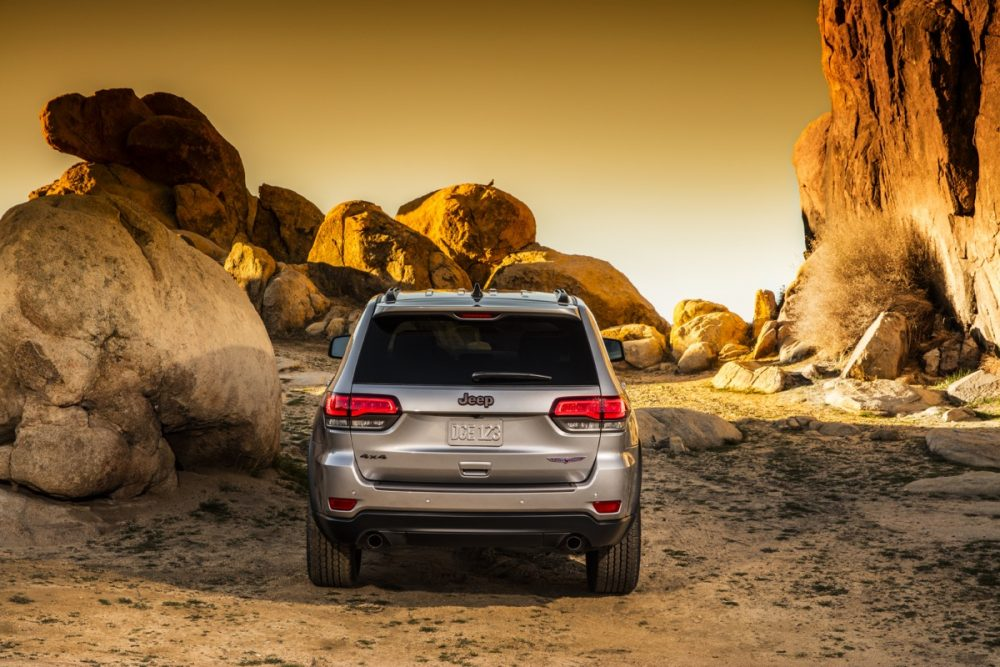 The 2021 Jeep Grand Cherokee Trailhawk in a sandy and rocky area