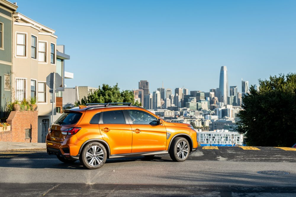 The 2021 Outlander Sport overlooking a city