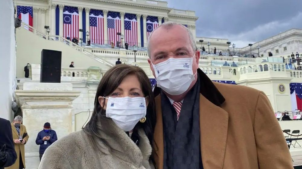 A couple wearing Ford-made face masks during the inauguration of President Joe Biden and Vice President Kamala Harris