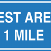 A sign that says the next rest area is one mile away