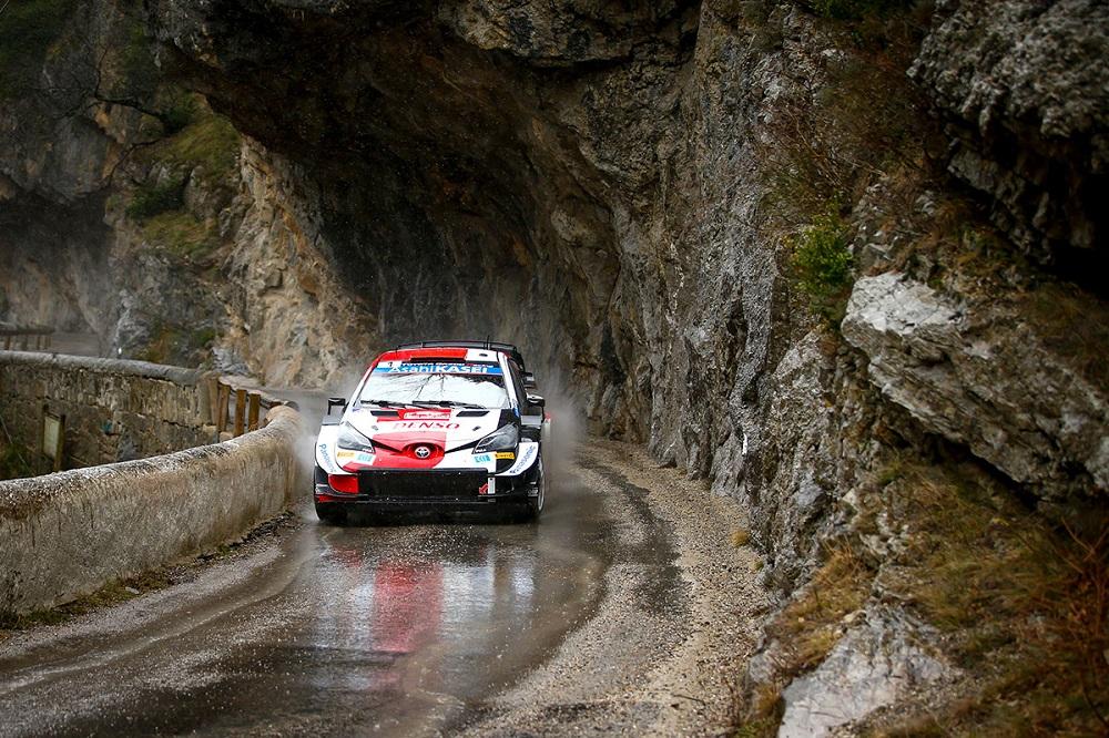 Yaris WRC at Rallye Monte Carlo, on wet tarmac next to a rock face