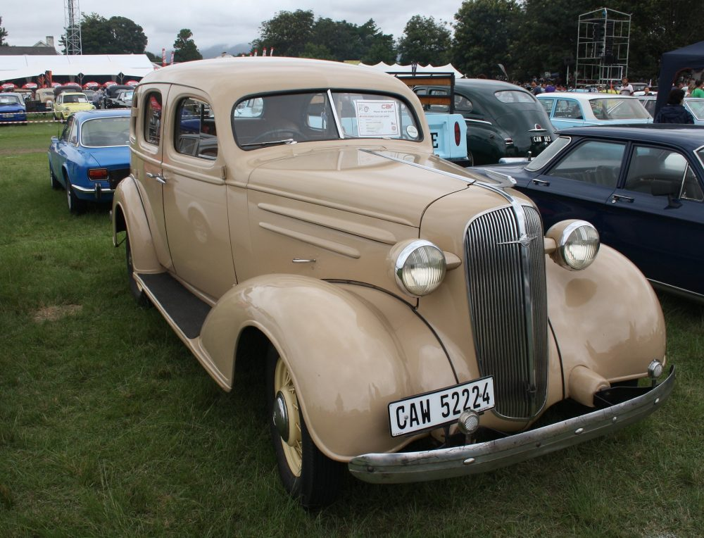 A tan 1937 Chevrolet Standard Four-Door, which is a street-car, but not a streetcar.