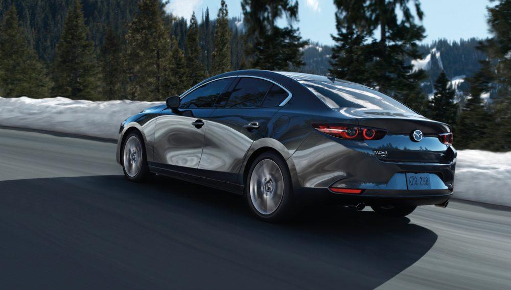 2020 Mazda3 Sedan driving on a winter road