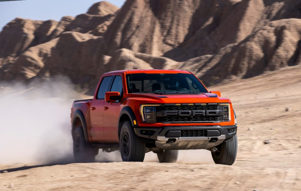 2021 Ford F-150 Raptor kicking up sand in the desert