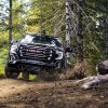Head-on view of 2021 GMC Sierra 1500 AT4 off-roading in woods