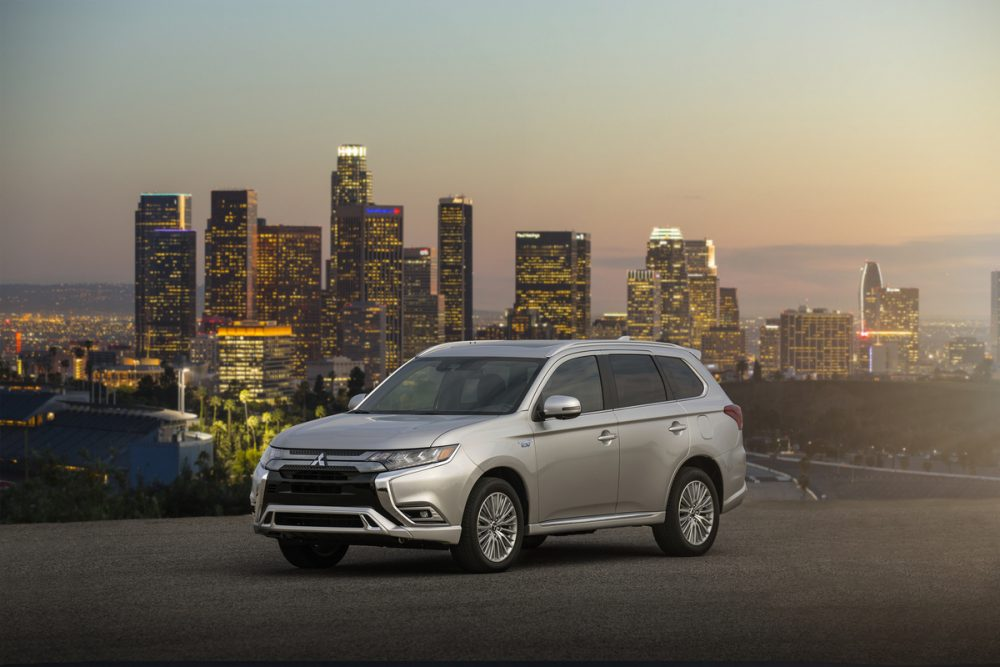 The 2021 Mitsubishi Outlander PHEV in front of a city