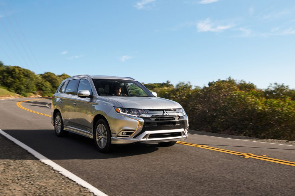 The 2021 Mitsubishi Outlander PHEV driving on the street