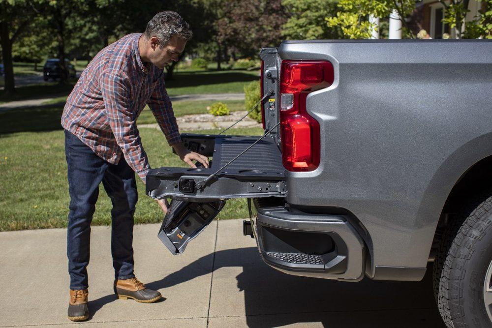 Man using 2021 Chevrolet Silverado 1500's Multi-Flex tailgate