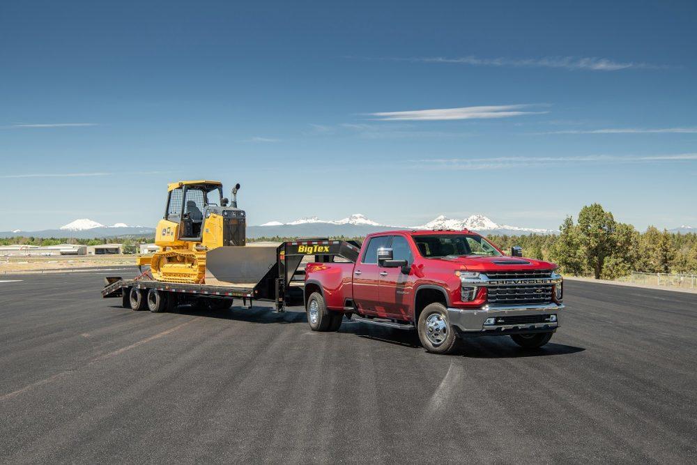 Dual-real-wheel 2021 Chevrolet Silverado 3500HD LTZ pulling trailer with construction vehicle