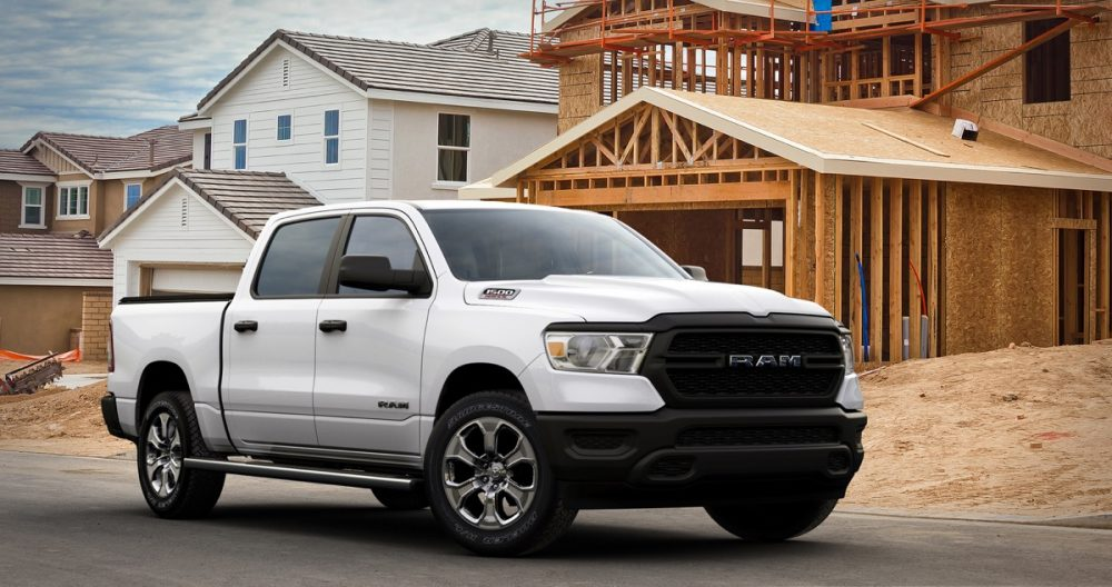 The 2021 Ram 1500 Tradesman HFE EcoDiesel in front of houses