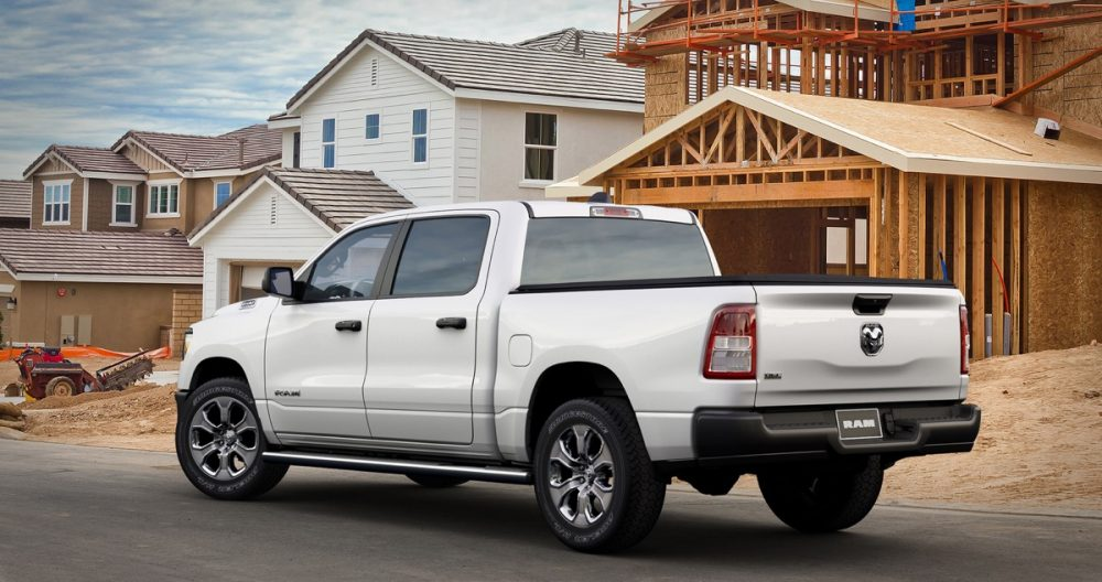 The 2021 Ram 1500 Tradesman HFE EcoDiesel in front of an unfinished house