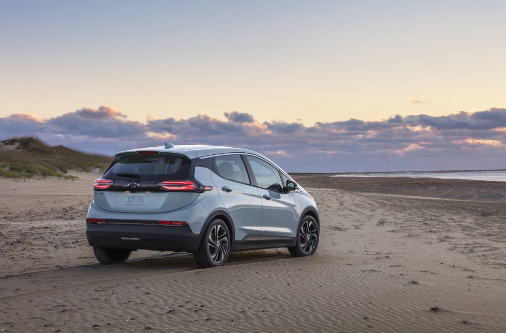 Rear side view of 2022 Chevrolet Bolt EV on beach