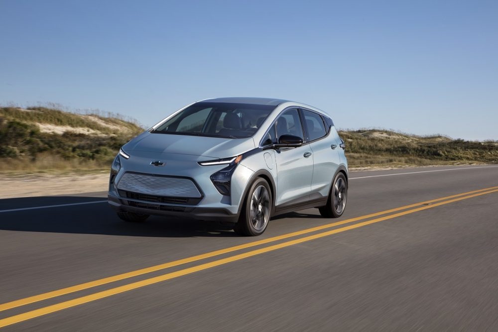 Front side view of 2022 Chevrolet Bolt EV driving down road