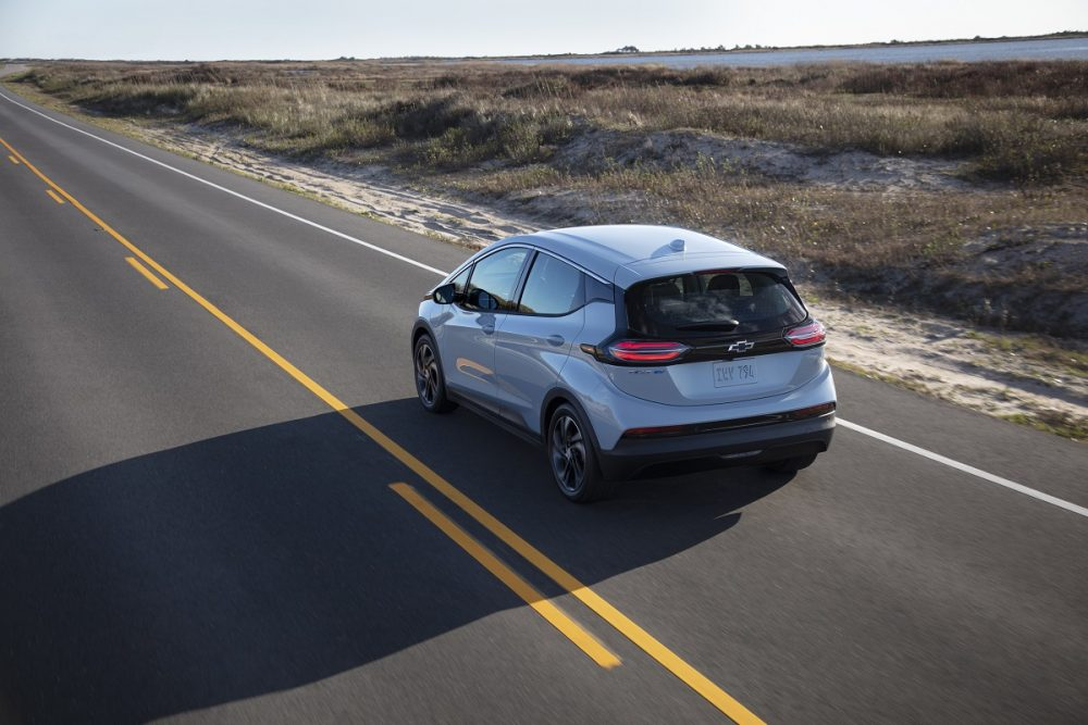 Rear overhead view of 2022 Chevrolet Bolt EV driving down road