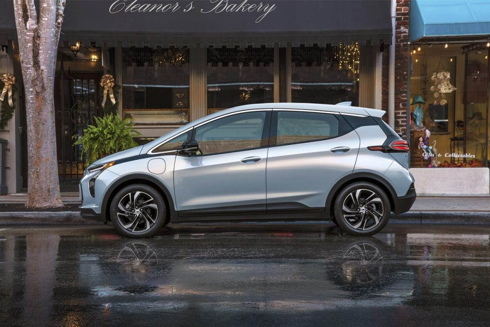 Side view of 2022 Chevrolet Bolt parked on street