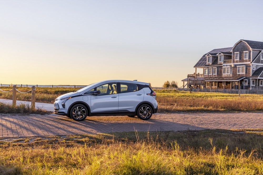 Side view of 2022 Chevrolet Bolt EV in countryside