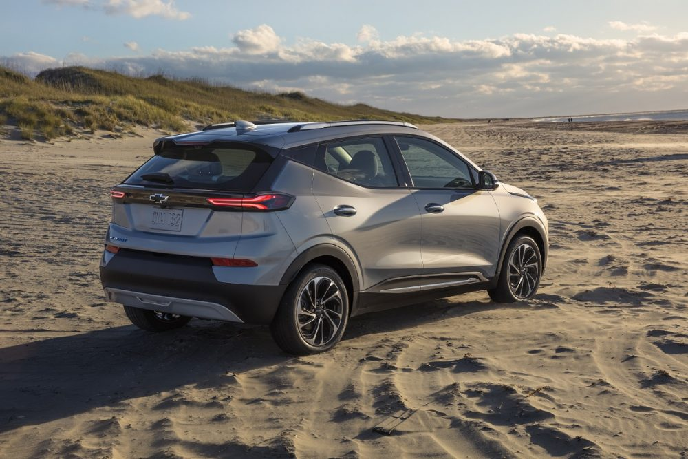 Rear side view of 2022 Chevrolet Bolt EUV on beach