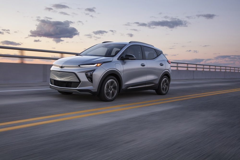 Front side view of 2022 Chevrolet Bolt EUV driving down road