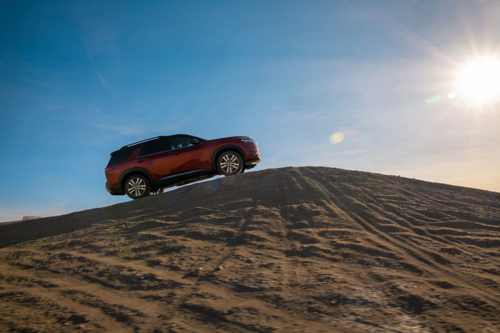 2022 Nissan Pathfinder climbing a hill in the desert