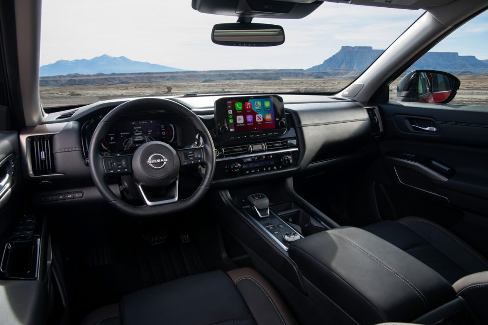 2022 Nissan Pathfinder interior front seats, with steering wheel and touch screen infotainment system shown