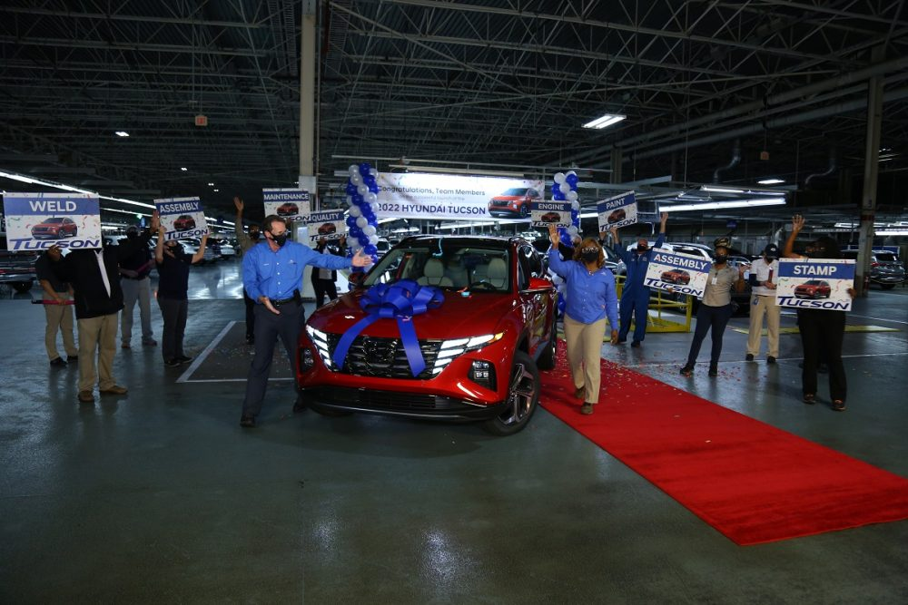 Hyundai Motor Manufacturing Alabama employees celebrate next to the 2022 Tucson