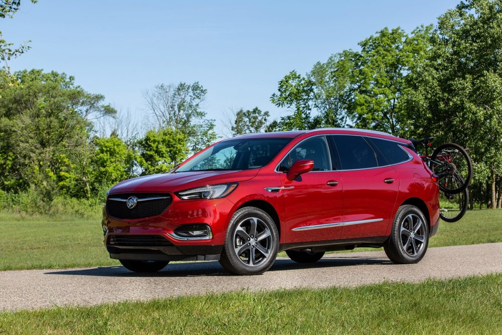 The Buick Enclave Sport Touring parked in front of a grassy field