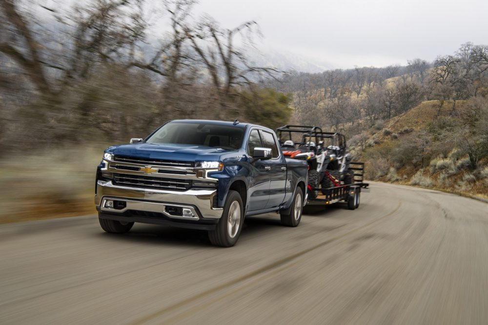 Front side view of Chevrolet Silverado 1500 towing a trailer