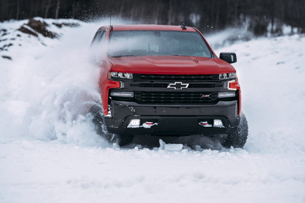 Front view of Chevrolet Silverado 1500 Trail Boss driving in snow