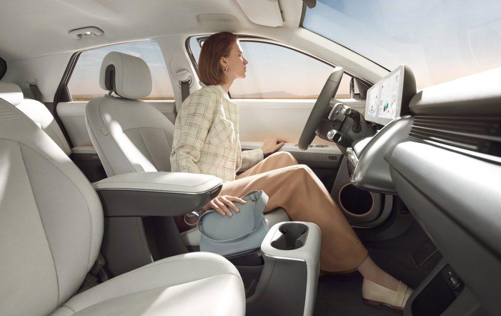 Woman sitting behind wheel of 2022 Hyundai Ioniq 5