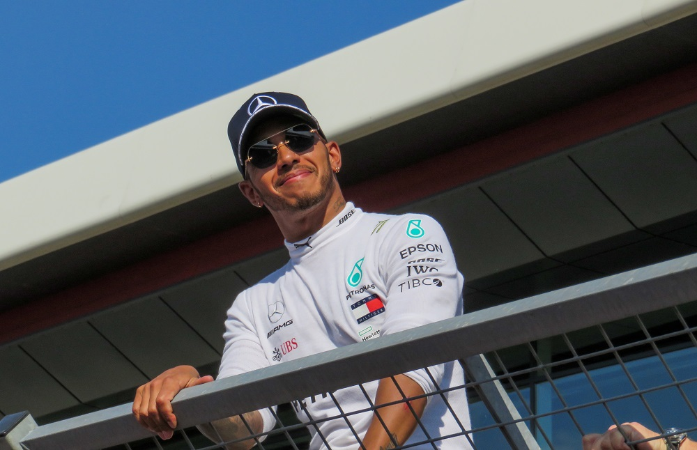 Lewis Hamilton smiling on the pit wall, at the 2018 British GP
